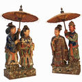 Pair of chinese 19th century glazed pottery figures of an aristocratic couple and their attendents